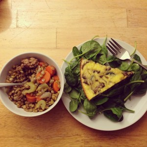 herbed lentils and veggie frittata on a bed of spinach