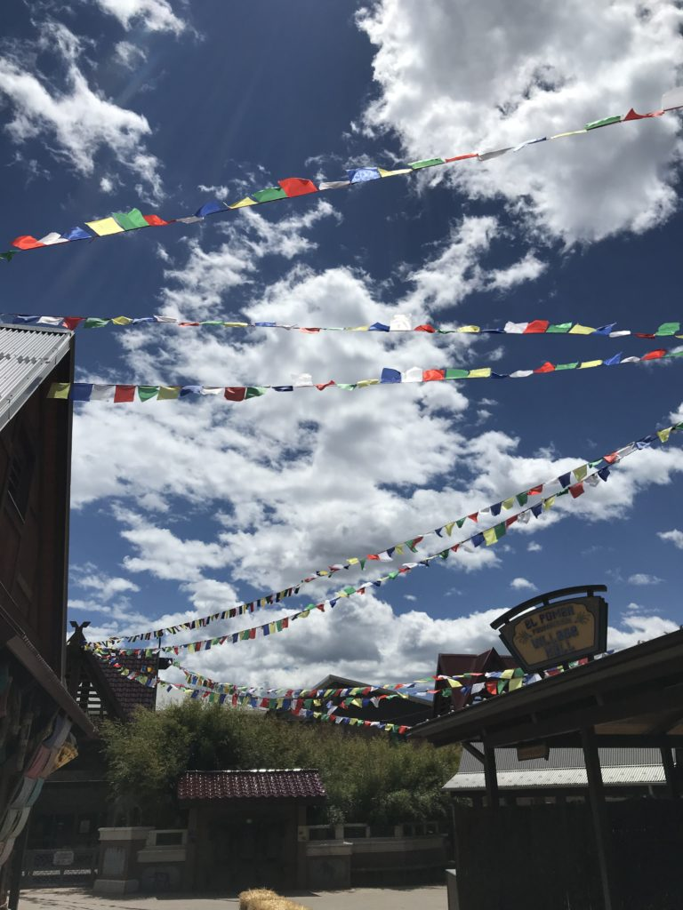 prayer flags blue sky and white clouds