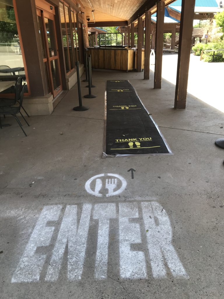 enter and physical distance spots to get in a restaurant