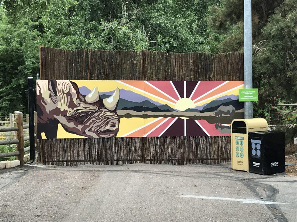 colorful rhino mural on rattan barrier